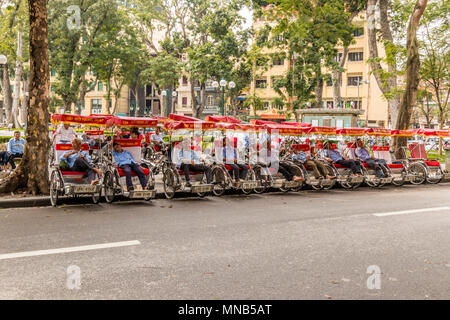 Cycle rickshaw drivers resting in Hanoi Vietnam - Stock Photo