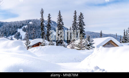 Snow covered roof tops of homes in the ski village of the famous Ski Resort Sun Peaks in beautiful British Columbia, Canada - Stock Photo