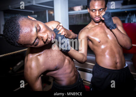 African American quick fighter punching in the chin his opponent - Stock Photo