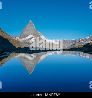 View on Matterhorn reflected in Lake  Riffelsee, near Zermatt, Switzerland. - Stock Photo
