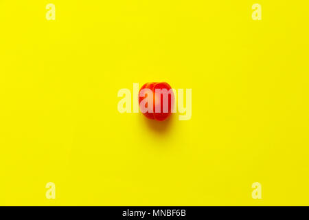 Lonely Apricot  isolated over a yellow background viewed from above, flatlay style - Stock Photo