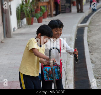 Children playing in danger near the railway track at Aguas Calientes. district of Machu Picchu. - Stock Photo