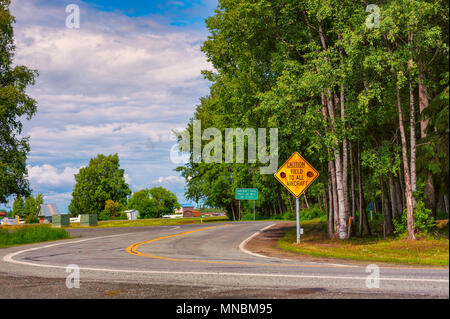 Road signs on the road that travels along Lake Hoods shores warning all traffic is to yield to aircraft that uses the lake as an airport. - Stock Photo