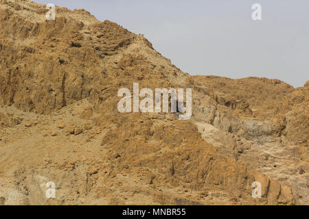 The barren mountainous wilderness at Qumran the historic archaeological site of the Dead Sea Scrolls in Israel - Stock Photo