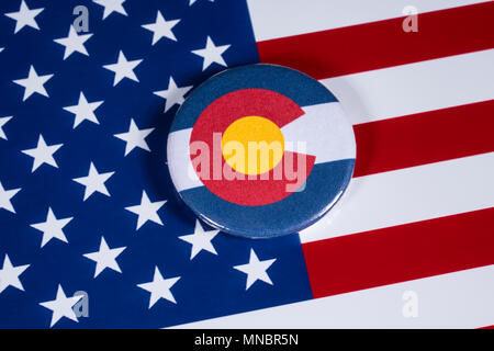 LONDON, UK - APRIL 27TH 2018: The symbol of the State of Colorado, pictured over the flag of the United States of America, on 27th April 2018. - Stock Photo