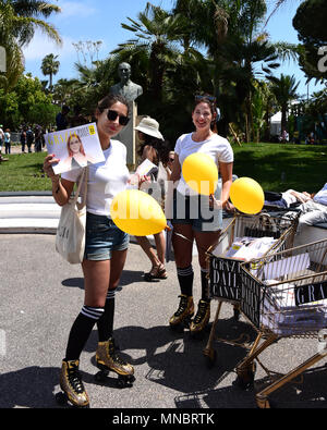 Cannes, France - May 11, 2018:  Grazia employees distributing the magazine to the crowd at the 71st  Cannes Film Festival. - Stock Photo