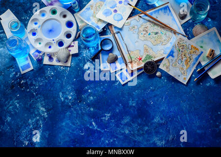 Artist workplace with a watercolor map, sketches, seashells and compass on a navy blue background with copy space. Travel flat lay header. - Stock Photo