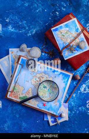 Sea travel and painting concept. Watercolor fantasy map on leather cover captain journals with a magnifying glass on a navy blue background with copy  - Stock Photo