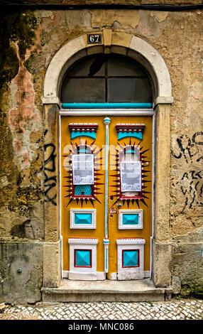 Door with attitude near Castelo de Sao Jorge, Lisbon - Stock Photo