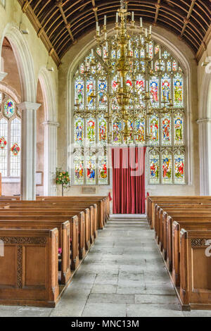 The west stained glass and nave at the medieval church of St Andrew in the village of Colyton, Devon, England. - Stock Photo