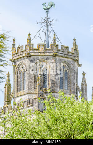 The octagonal (lantern) tower and weather vane at the medieval church of St Andrew in the village of Colyton, Devon, England. - Stock Photo