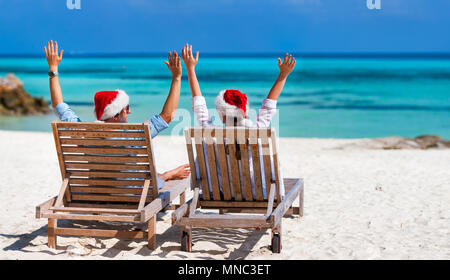 Girl in christmas hat relaxing near swimming pool summer - Swimming pool girl christmas vacation ...