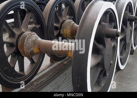 Steam train wheels waiting to be fitted during routine maintenance in a railway workshop. - Stock Photo