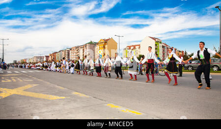 NOVI SAD, SERBIA-OCT 4, 2015: Guinness World Record Largest Folk Dance on Oct 4. 2015 in Novi Sad, Serbia. Over 12.000 participants break the Guinness - Stock Photo