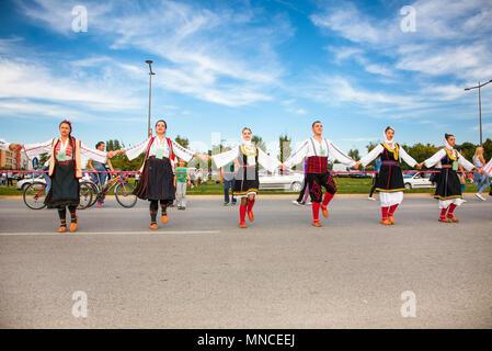 NOVI SAD, SERBIA-OCT 4, 2015: Guinness World Record Largest Folk Dance on Oct 4. 2015 in Novi Sad, Serbia. Over 12.000 participants break the Guinness - Stock Photo