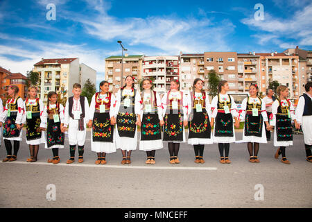 NOVI SAD, SERBIA-OCT 4, 2015: Guinness World Record Largest Folk Dance on Oct 4. 2015 in Novi Sad, Serbia. Over 12.000 participants prepares to break  - Stock Photo