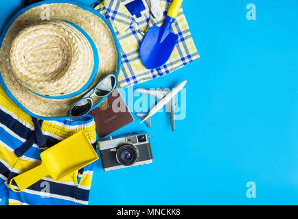 Boy travel accessories, fashion  and toys on blue copy space - Stock Photo