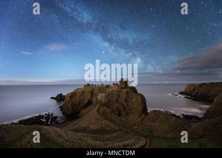 The Milky Way over Dunnottar Castle on the east coast of Scotland near Stonehaven in Aberdeenshire - Stock Photo