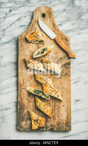 Freshly baked Turkish borek roll slices with cheese and spinach - Stock Photo
