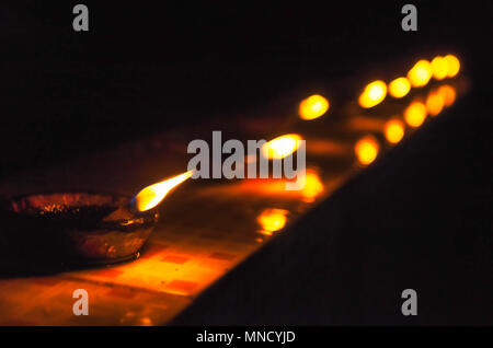 A row of oil lamps during Diwali in India - Stock Photo