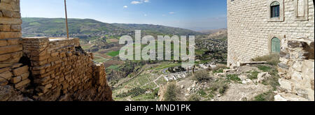 View from the Crusader castle to a small Jordanian village, a suburb of the big city Karak, middle east - Stock Photo