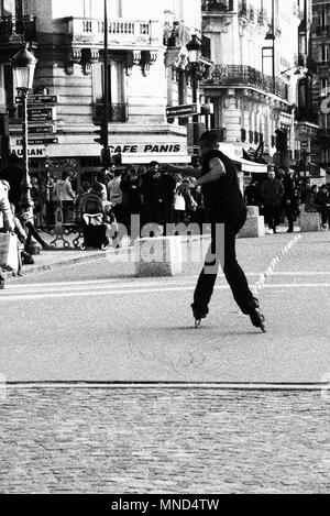A man scating in fron of Notre Damme Cathedral,Paris,Saint Micheal,France - Stock Photo