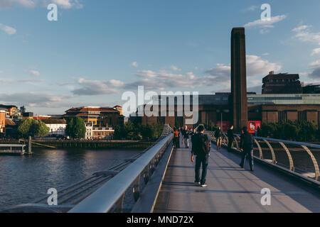 LONDON - MAY 10, 2018: People walking on Millennium Bridge in London towards Tate Modern building - Stock Photo