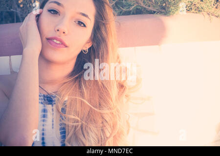 Young nice woman in a close up portrait, long hair and beautiful face. Vintage filter - Stock Photo