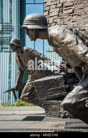 Detail of two Polish resistance fighters portrayed in the Monument To The Warsaw Rising in Plac Krasinskich in the center of Warsaw, Poland. - Stock Photo