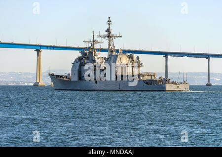 USS Princeton at San Diego Bay - The guided-missile cruiser is sailing towards Coronado Bridge at its homeport of Naval Base in San Diego Bay, CA, USA - Stock Photo