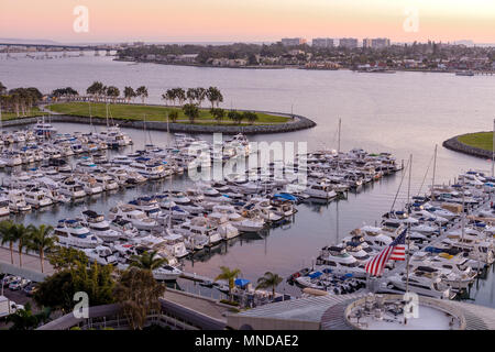 Sunset San Diego Bay - An aerial sunset view of San Diego Bay and San Diego Marina, with Coronado Bridge and Coronado Peninsula in background. CA, USA - Stock Photo