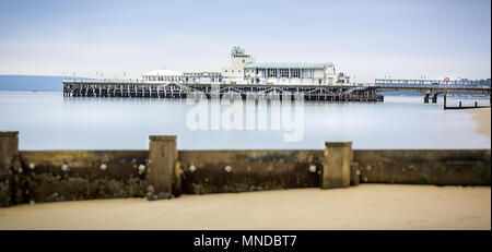 Long exposure of Boscombe Pier with groyne in foreground taken in Boscombe, Dorset, UK on 28 November 2013 - Stock Photo