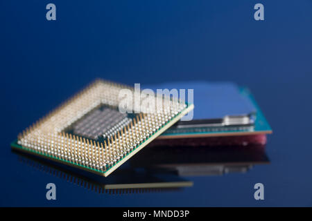 Central processing unit CPU processors microchip on blue background - Stock Photo