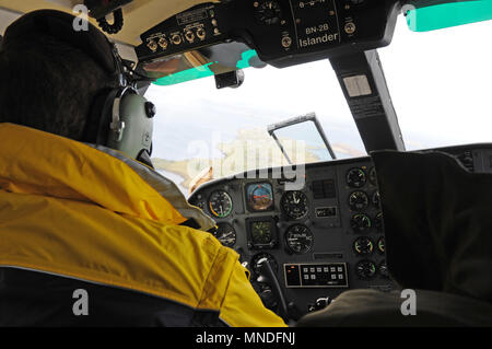 Inside Britten Norman BN-2 islander aircraft flying between Shetland mainland and Fair Isle - Stock Photo