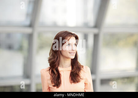 close up.portrait of modern young woman on blurred office background. - Stock Photo