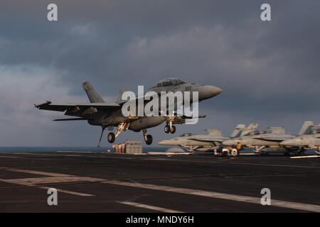 180513-N-NQ487-0453 MEDITERRANEAN SEA (May 13, 2018) An F/A-18F Super Hornet assigned to the 'Fighting Checkmates' of Strike Fighter Squadron (VFA) 211 prepares to land on the flight deck of the Nimitz-class aircraft carrier USS Harry S. Truman (CVN 75), May 13, 2018. Harry S. Truman's support of Operation Inherent Resolve demonstrates the capability and flexibility of U.S. Naval Forces and their resolve to eliminate the terrorist group ISIS and the they pose. (U.S. Navy photo by Mass Communication Specialist 3rd Class Kaysee Lohmann/Released). () - Stock Photo