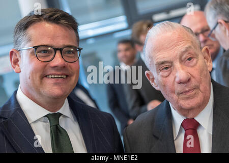 16 May 2018, Germany, Frankfurt: Hesse's Economy Minister Boris Rhein (L) of the Christian Democratic Union (CDU) in conversation with Gerhard Wiese. Wiese is the former prosecuting counsel in the Frankfurt Auschwitz trials. The documents of the 1st Frankfurt Auschwitz trialis now a UNESCO World Heritage Document. Photo: Boris Roessler/dpa - Stock Photo