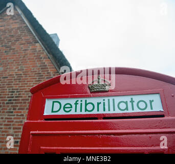 Leicestershire, UK. 16th May 2018. An old telephone box has a defibrillator installed in the village of Tur Langton, Leicestershire, UK. © flab lstr / Alamy Live News - Stock Photo