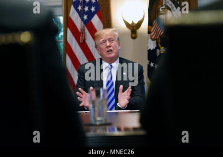 Washington, USA. 16th May 2018. United States President Donald J. Trump makes during a roundtable meeting with leaders and public officials from California who oppose their state's sanctuary policies that in their opinion release criminal illegal aliens into public communities, in the Cabinet Room of the White House, May 16, 2018 in Washington, DC. Credit: Olivier Douliery/Pool via CNP /MediaPunch Credit: MediaPunch Inc/Alamy Live News - Stock Photo