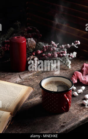hot coffee on a wooden table, in Christmas decorations