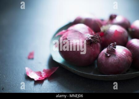 Red onions on a plate - Stock Photo