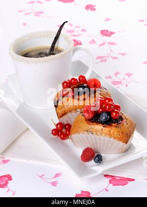 Small berry cakes and coffee - Stock Photo
