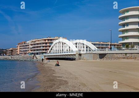 Beach and modern bridge at Sainte-Maxime, Cote d'Azur, Département Var, Provence-Alpes-Côte d'Azur, South France, France, Europe - Stock Photo