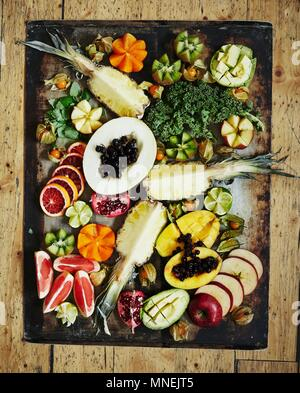 Various fruits on a vintage tray Healthy greens - Stock Photo