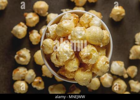 Popcorn in a cup (top view) - Stock Photo