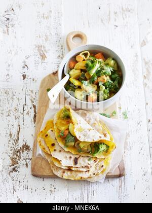 Savoury pancakes with vegetables (China) - Stock Photo