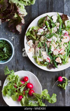 A Cous Cous Salad with Radish, String Beans, Feta and Parsley - Stock Photo