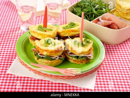 Omelette sandwiches with cured ham and rocket - Stock Photo