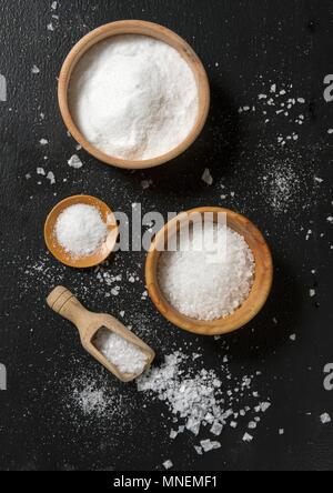 An arrangement of various different types of salt (seen from above) - Stock Photo