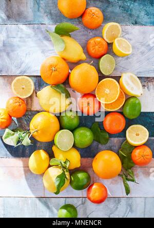 Citrus fruits, whole and sliced - Stock Photo